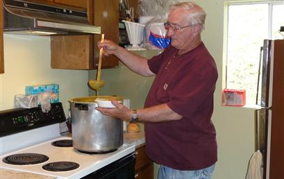 Ron is serving up soup to the clients. Every Wednesday. Ron prepares delicious homemade soup and bread. We welcome our clients in for a hearty meal, fellowship and food boxes.